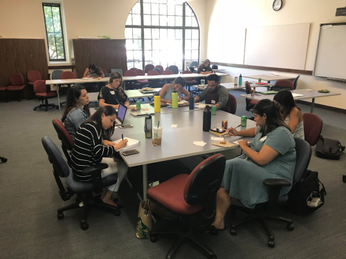 Image of students working together in a group setting
