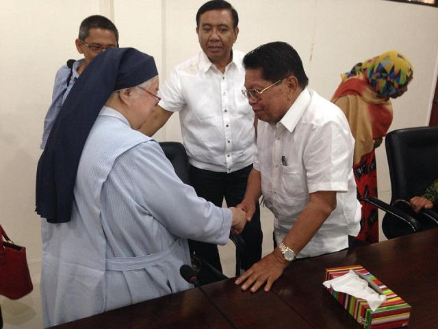 Sister Arnold Maria Noel shakes hands with Moro leader in the Philippines