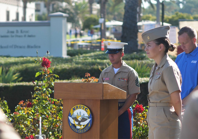 Image from 9/11 remembrance event featuring members from the NROTC color guard in the memorial garden