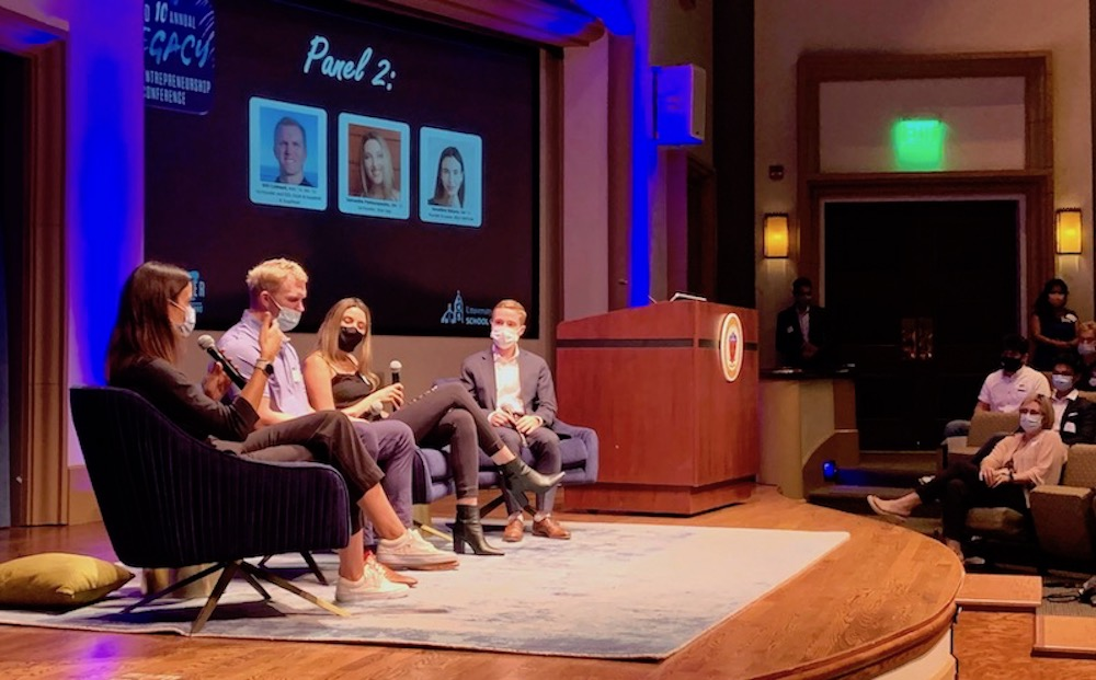 Geraldine Ridaura, Will Caldwell, and Samantha Pantazapolous sit on stage at USD to speak on panel for Legacy Entrepreneurship Conference