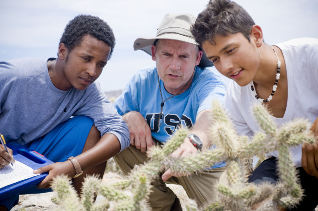 Dr. Drew Talley working with students at a research site in Baja California
