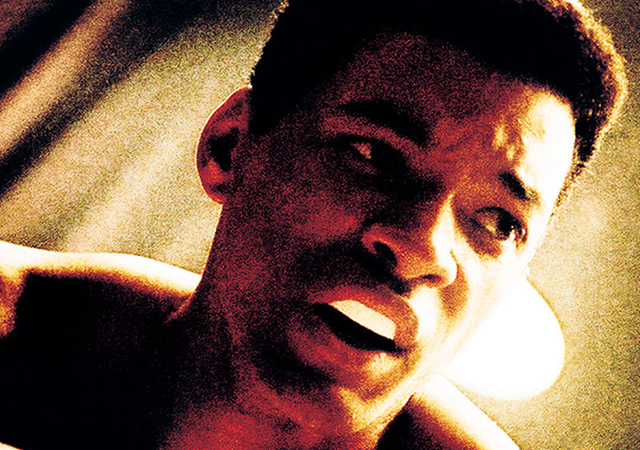 Movie still of a closeup shot of Will Smith portraying Mohammad Ali.