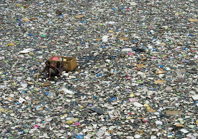 Man among plastic waste