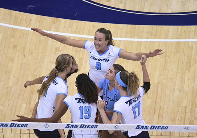 USD Volleyball team huddle