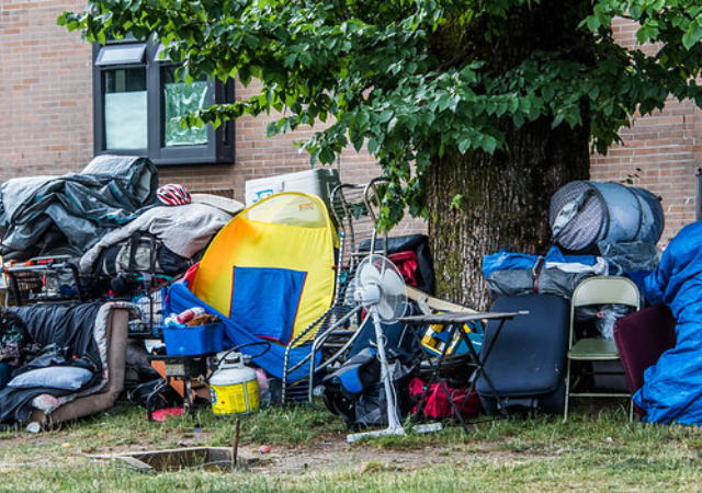 Piles of a person's belongings outside