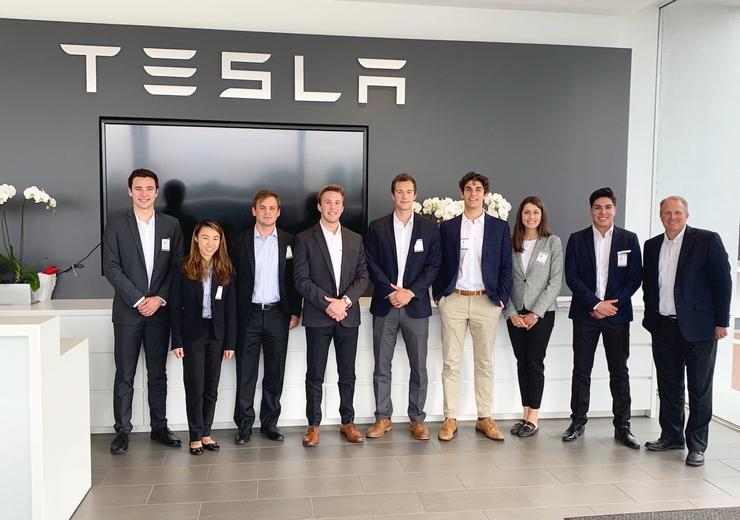 The USD SIBC Tesla student team smiles at Tesla headquarters in Fremont, CA