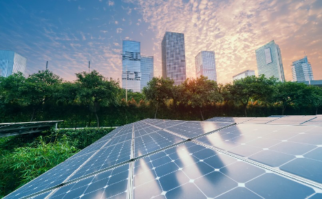 Solar panels with a city skyline in the background