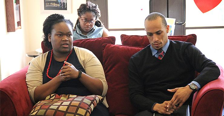 USD Assistant Professor of Mathematics, Candice Price, PhD, speaks as fellow Assistant Professor of Political Science, Cory Gooding, PhD, listens during a Beyond the Classroom event.