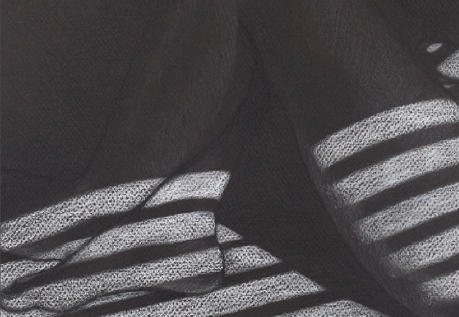 Black and white photo of foot and leg in shadows