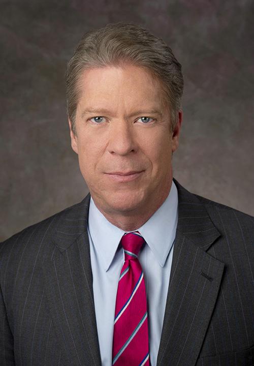 headshot of Garrett