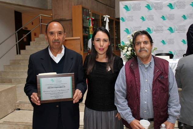 Fernando Ocegueda (left), with President Melba Olvera of the State Human Rights Commission, and Fernando Ortigoza