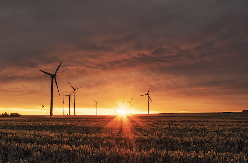 Sunrise with wind turbines