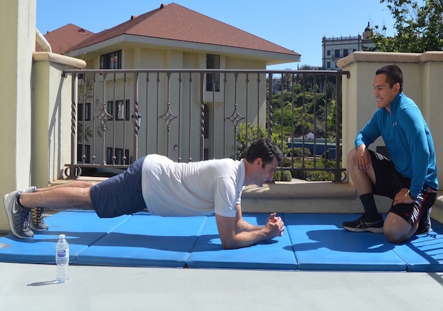 USD Personal Trainer Matt working out with one of his clients at the Mission Fitness Center.