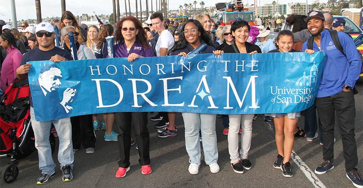 University of San Diego students and other members of the USD community are encouraged to join and walk together in the Jan. 14 Dr. Martin Luther King Jr. Parade in downtown San Diego.