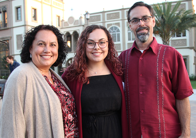 Sage McNeeley, middle, celebrates her academic achievement with family after attending the Mid-Year Graduates Mass in Founders Chapel on Dec. 13, 2019.