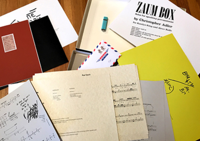 Open box with music scores printed on paper of various types and sizes.