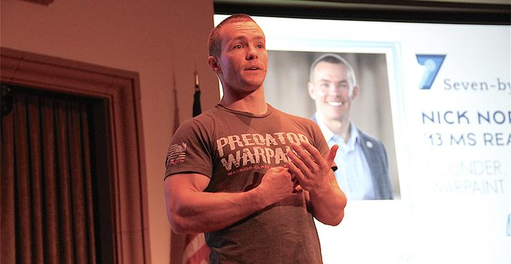 Former Navy SEAL Nick Norris, a 2013 USD alumnus (MS Real Estate), talks about his company Predator Warpaint during a School of Business alumni event on innovation and creativity.