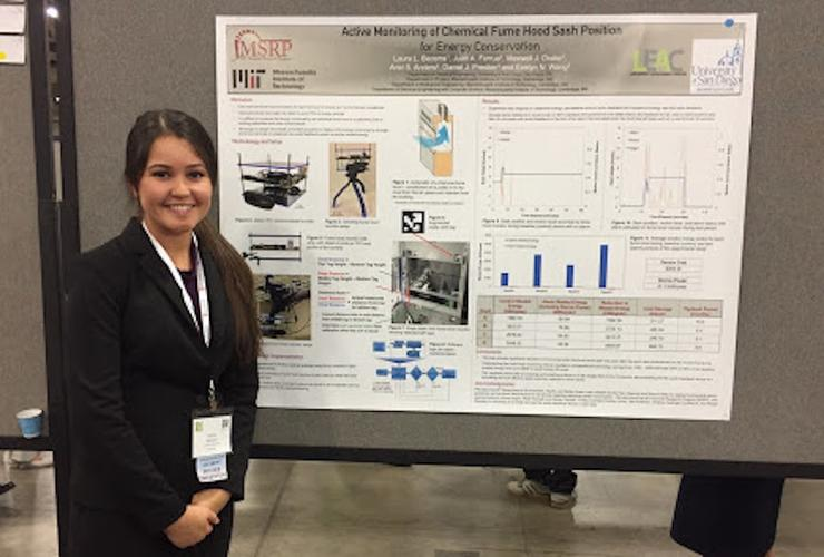 Engineering student Laura Becerra stands with her research poster that she presented at the recent SACNAS National Conference in Salt Lake City.