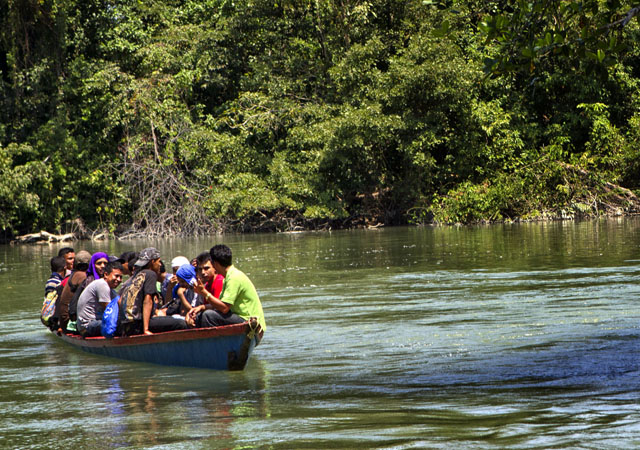 Migrants Crossing a Mexican River