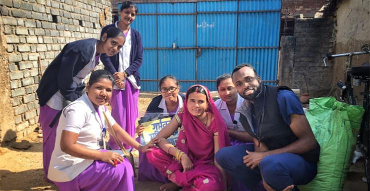 Second-year University of San Diego MEPN student,  Hezekiah O'Neal (far right) with Christian Hospital Mugeli, India, nursing students, provided health care in the local rural village.