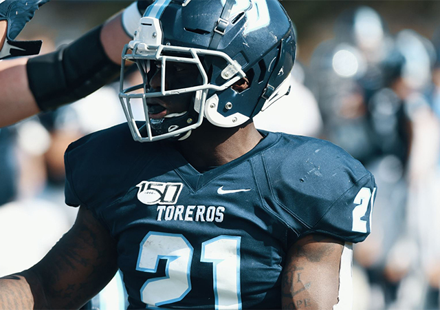 Toreros running back JoJo Binda Jr. is congratulated after scoring one of his three touchdowns in a win over Drake.