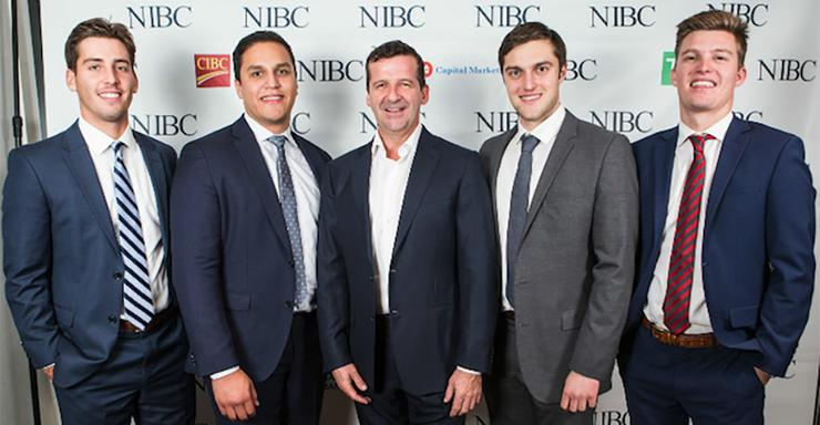 Finance students (L to R) Sean Dedmond, Alex Hernandez, Entertainment One CEO Darren Throop, Peter Twomey and Barrett Thornton took second place in a National Investment Banking Competition.