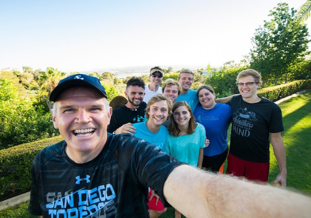 President James Harris with USD students on a hike