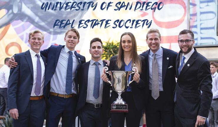 Picture of students holding trophy from the Real Estate Society