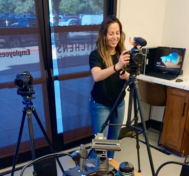 Rachael Ponn, USD MBA student, sets up video equipment