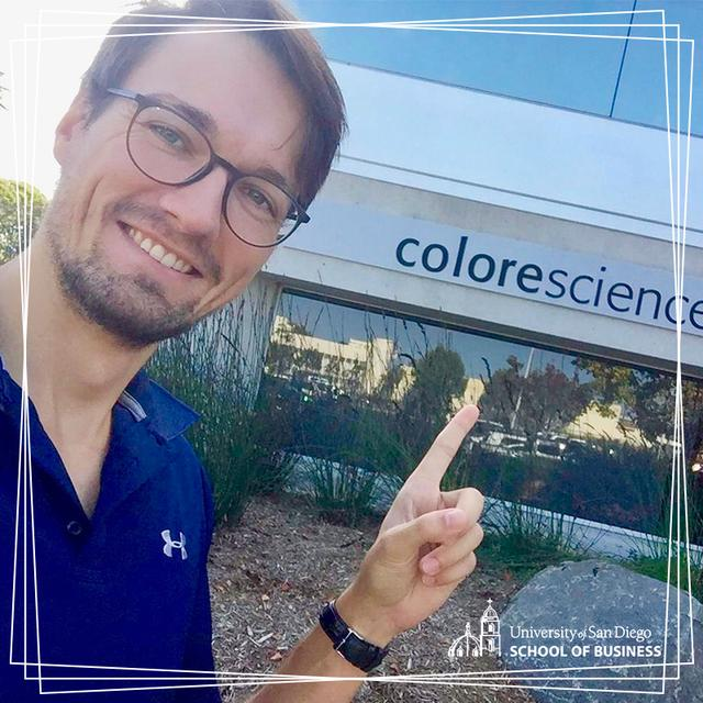 USD exchange student Tim Heitplatz points to the Colorescience office building