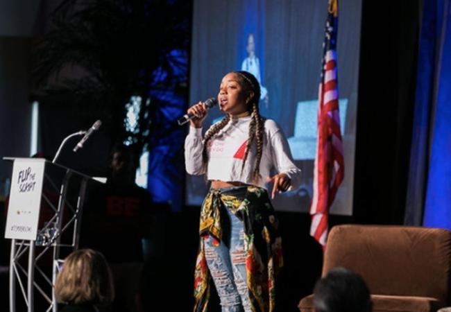 student speaking on stage