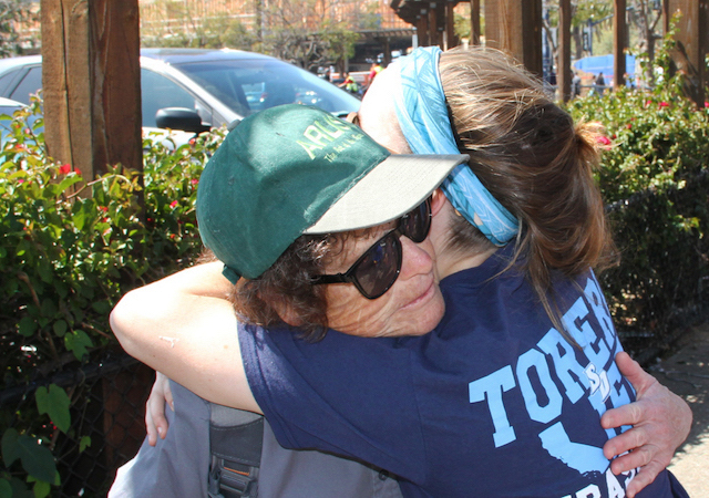 A USD student embraces someone in downtown San Diego