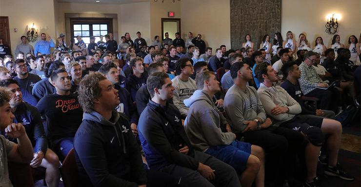 The 2018 USD football team and team supporters watch and wait to hear the Toreros' name called during the FCS Playoff bracket reveal on Sunday.