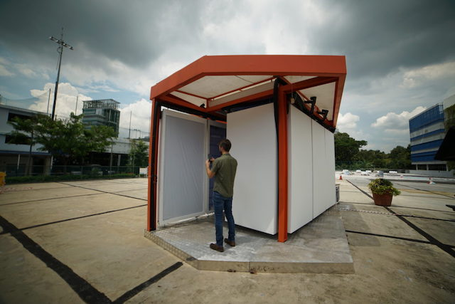 Exterior of Cold Tube demonstration pavilion. Small standalone room with white panels