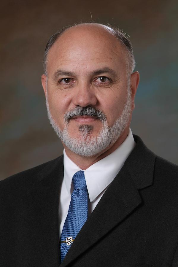 Dr. Reyes L. Quezada