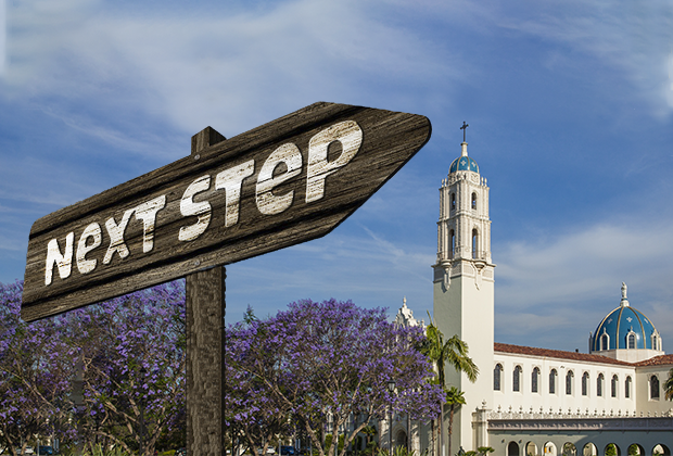 "image of a wooden arrow that says, ""next step"" with the immaculata in the background"
