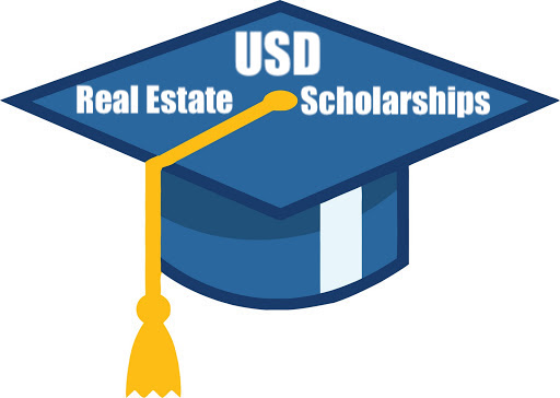 Graduation cap with writing that says USD Real Estate Scholarships