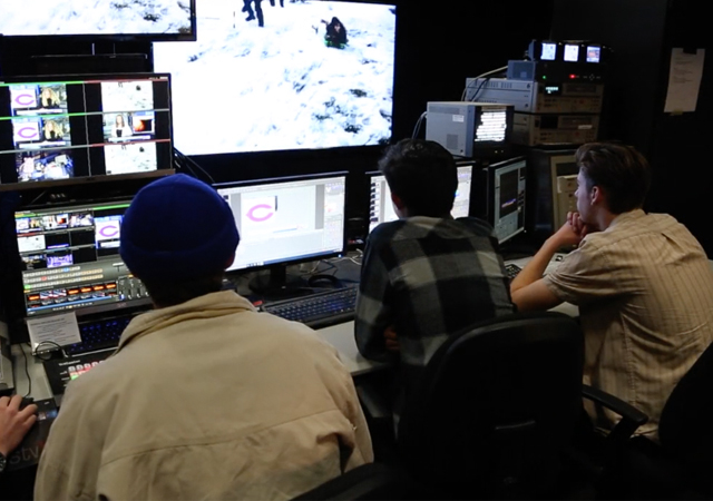 students working on editing in a video production room