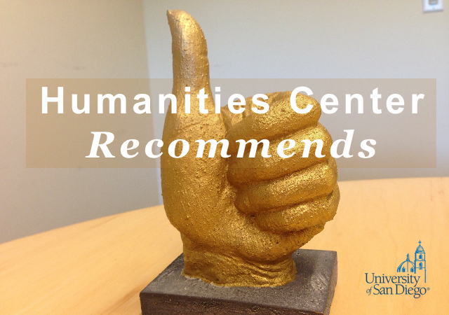 gold statue of a hand giving the thumbs up sign