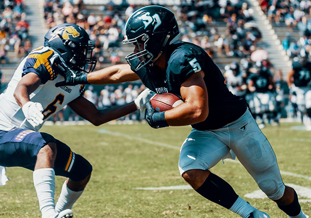 Wide receiver Michael Bandy, running with the ball, is a key USD football player for 2019