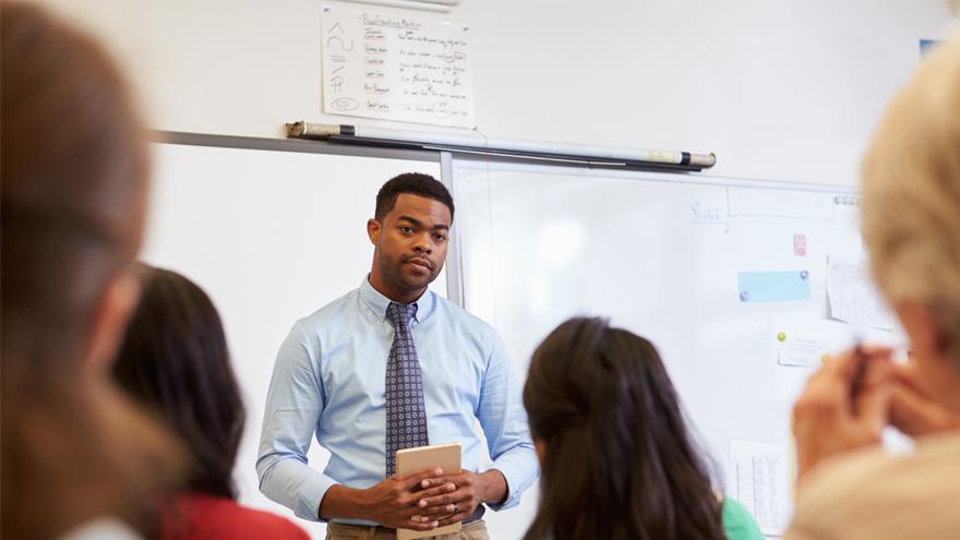 teacher presenting to other teachers