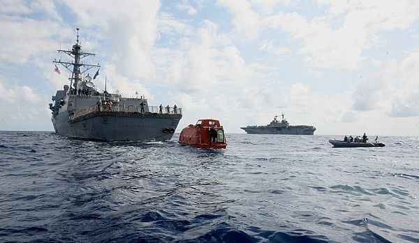MV Maersk Alabama lifeboat behind a US Navy destroyer and amphibious assault ship.