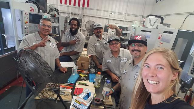 Leslie with the members of Rise Up Industries at the machine shop in Santee, CA.