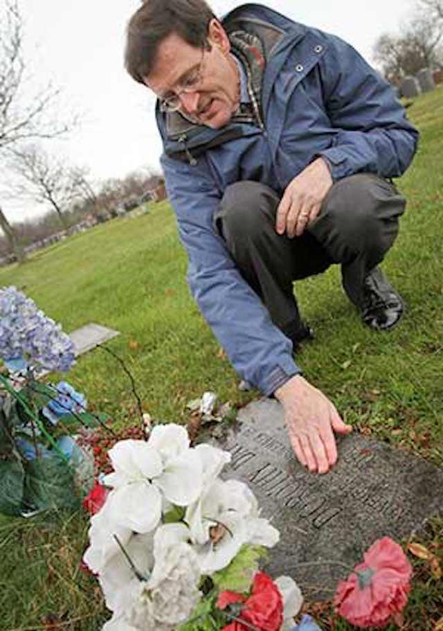 patrick jordan kneeling by Dorothy Day's gravesite