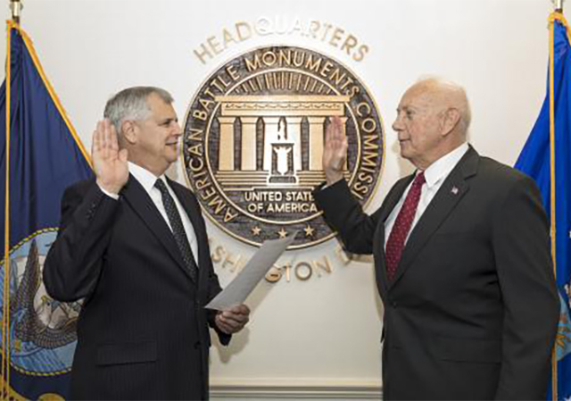 USD alumnus William M. Matz Jr., '73 (MA), right, takes oath to be secretary of the American Battle Monuments Commission.