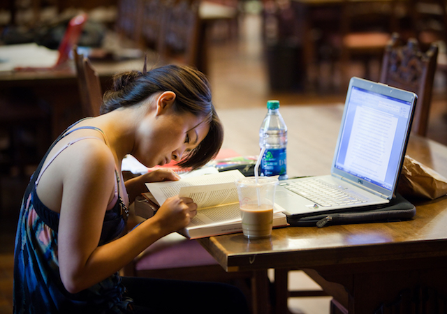 Student studying inside Copley Library
