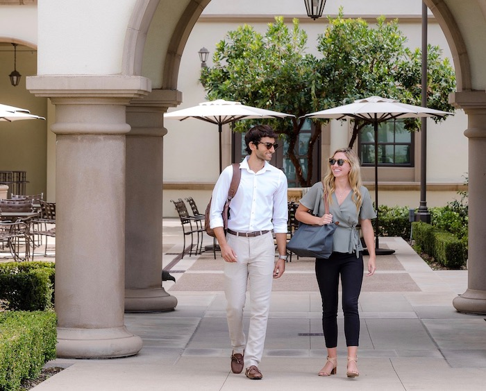 Two business students walk on University of San Diego campus