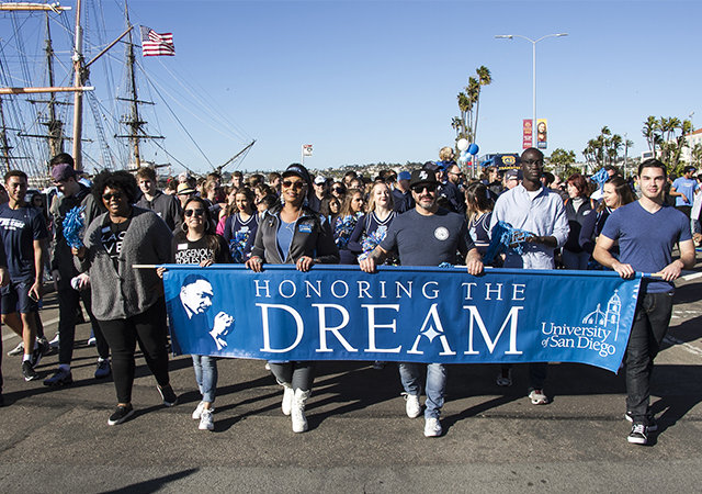 MLK Parade photo from 2019 parade with USD's MLK banner