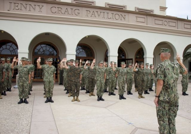 Captain Olin swears in the new members of the unit as Midshipmen in front of the Jenny Craig Pavilion.