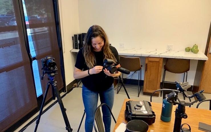 Rachael Ponn, USD MBA student, sets up video equipment
